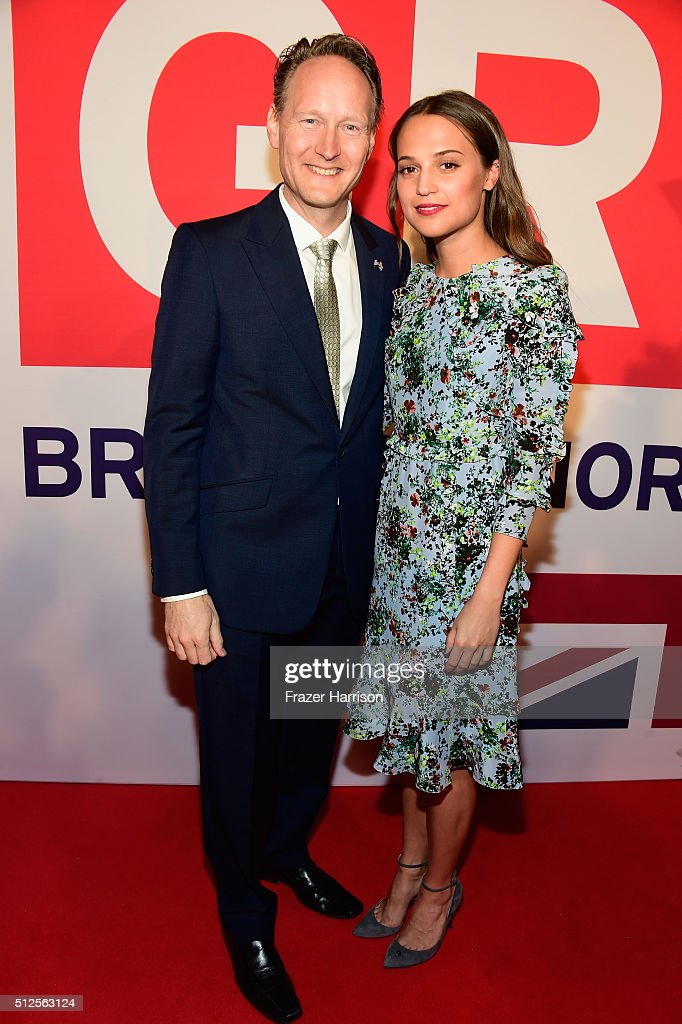 British Consul General in Los Angeles Chris O'Connor and Alicia Vikander attend the Film is GREAT Reception at Fig & Olive on February 26, 2016 in West Hollywood, California.