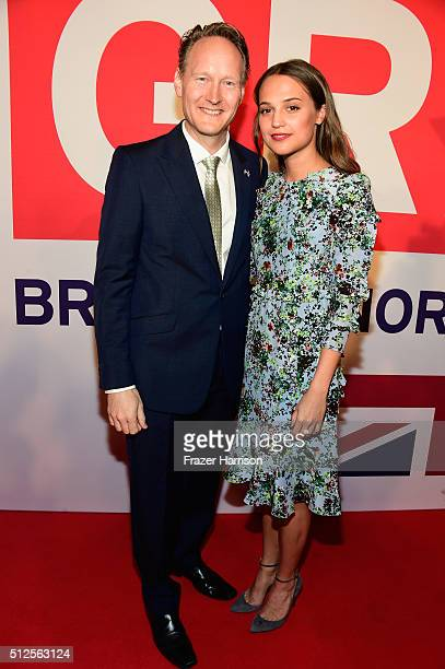 British Consul General in Los Angeles Chris O'Connor and Alicia Vikander attend the Film is GREAT Reception at Fig & Olive on February 26, 2016 in...