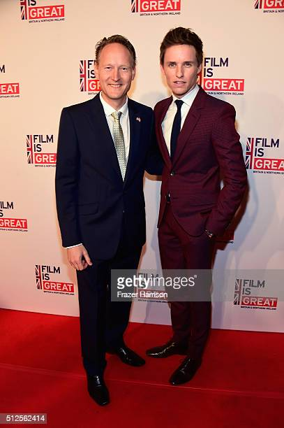 British Consul General in Los Angeles Chris O'Connor and Eddie Redmayne attend the Film is GREAT Reception at Fig & Olive on February 26, 2016 in...