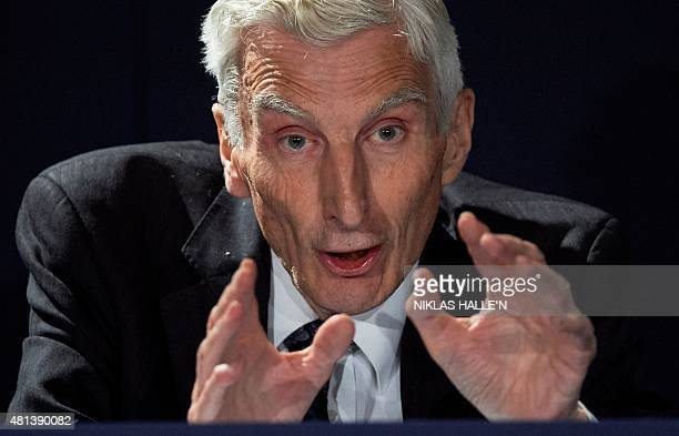 British cosmologist Professor Baron Martin Rees of Ludlow speaks during a news conference in London on July 20 where British scientist Stephen...