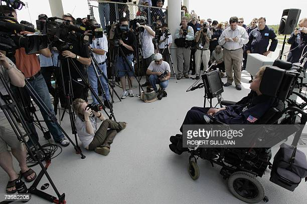 British cosmologist Stephen Hawking has his communication device adjusted by an aide at a preflight press conference 26 April 2007 at Kennedy Space...