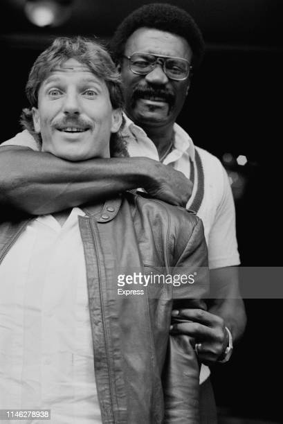 British cricketer Ian Botham jokes with West Indies cricketer Clive Lloyd, UK, 15th May 1984.