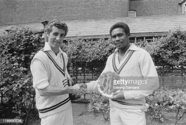 British cricketer Mike Brearley presents Barbadian cricketer Gordon Greenidge with a silver plate as they shake hands ahead of the 5th Test between...