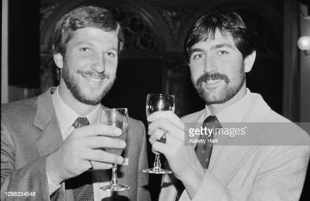 British cricketers Ian Botham and Graham Gooch having a drink together UK 30th September 1980