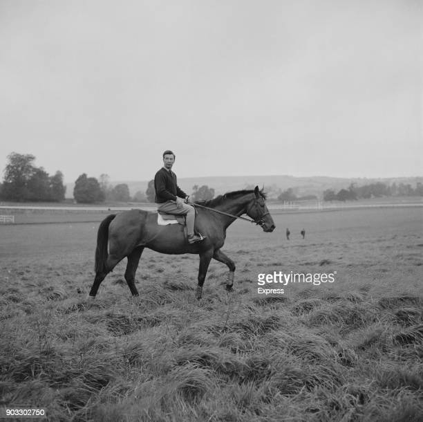 British crime writer and steeplechase jockey Dick Francis riding racehorse 'Persian War', UK, 3rd October 1968.