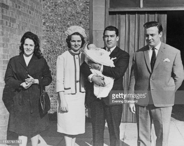 British criminal and gangster Ronald 'Ronnie' Kray holding a baby with two unidentified woman and an unidentified man UK 22nd May 1969