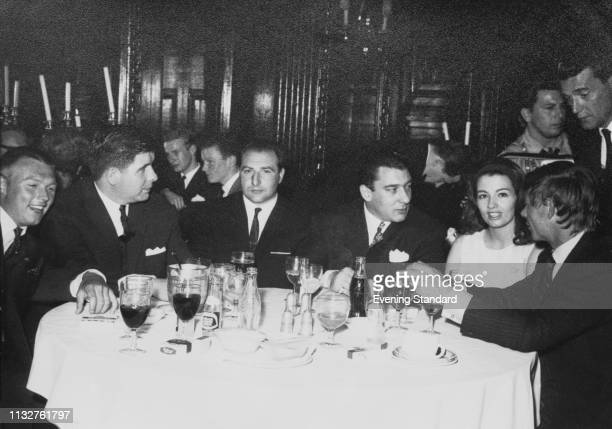 British criminal and gangster Ronald 'Ronnie' Kray with English model and showgirl Christine Keeler and others at a restaurant London UK 5th March...