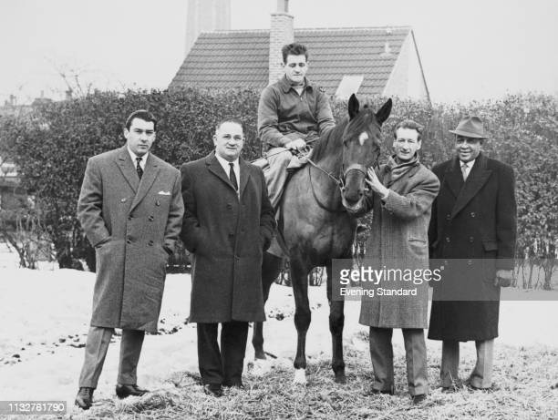 British criminal and gangster Ronald 'Ronnie' Kray with three unidentified men and jockey on a racehorse UK 20th May 1969