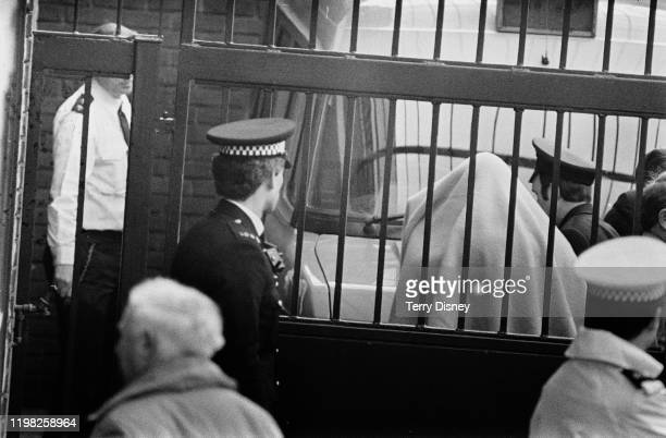 British criminal Malcolm Fairley AKA The Fox arrives at St Albans Crown Court escorted by police UK 27th February 1985