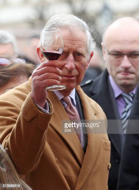British Crown Prince Charles and his wife Camilla the Duchess of Cornwall taste local wines as they visit a market with traditional products on March...