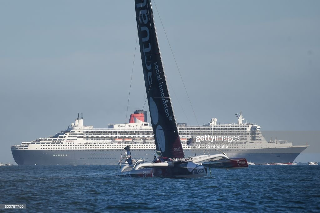 British cruise ship Queen Mary 2 and Class Ultim trimaran
