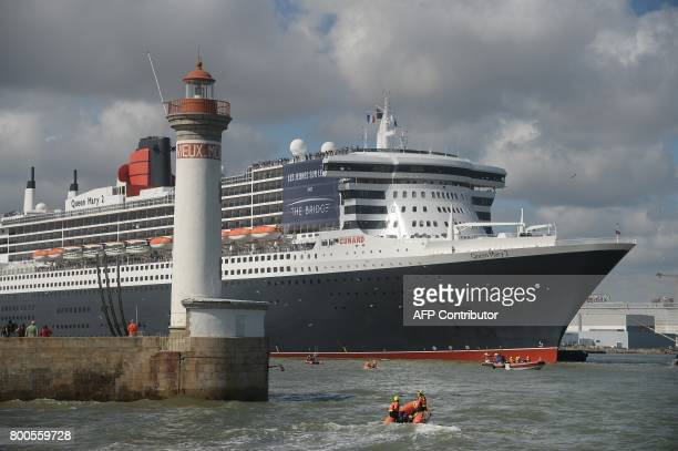 British cruise ship Queen Mary 2 arrives in SaintNazaire western France on June 24 on the eve of the start of The Bridge 2017 a transatlantic race...