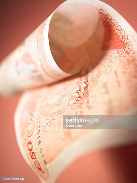 British Currency: Curled fifty pound banknote, close-up
