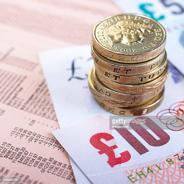 british currency on financial newspaper - ten pound note stock photos and pictures