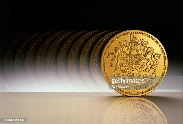 British Currency: One pound coin, rolling (Multiple exposure)