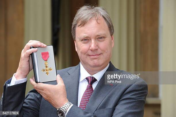British Cycling President Robert Howden poses after he received his Officer of Order of the British Empire medal from the Princess Royal during an...