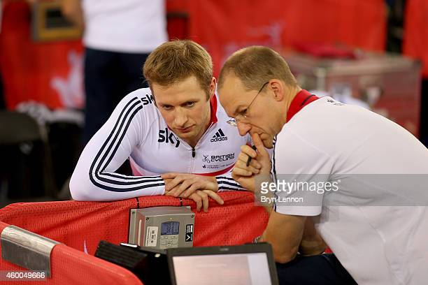 British Cycling track sprint coach Iain Dyer speaks to Team GB sprinter Jason Kenny on day two of the UCI Track Cycling World Cup at the Lee Valley...