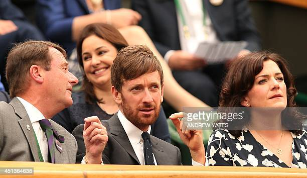 British cyclist Bradley Wiggins and his wife Catherine sit in the royal box on centre court before the start of the men's singles third round match...