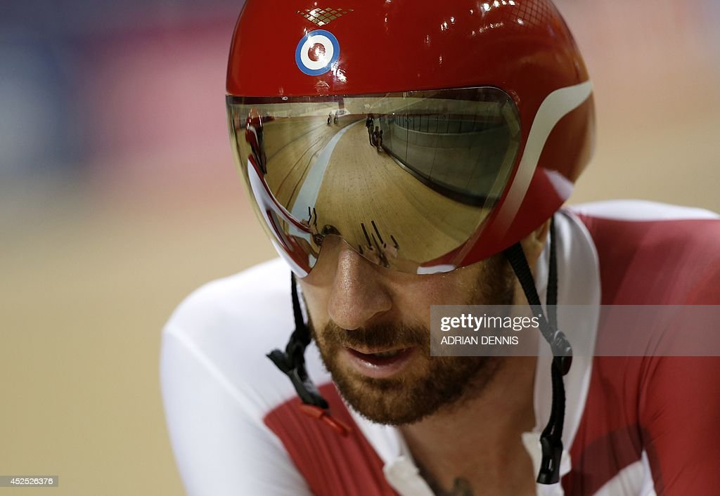 British cyclist Bradley Wiggins rides past during a training session at the Sir Chris Hoy Velodrome at the Emirates Arena in Glasgow on July 22, 2014, ahead of the start of the 2014 Commonwealth Ga...