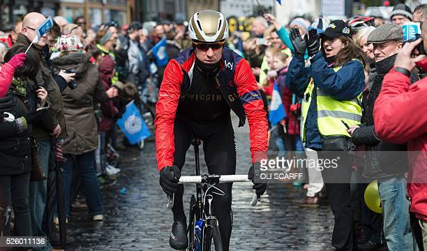 British cyclist Bradley Wiggins riding for Team Wiggins makes his way to the start line to compete in the first stage of the Tour de Yorkshire in...
