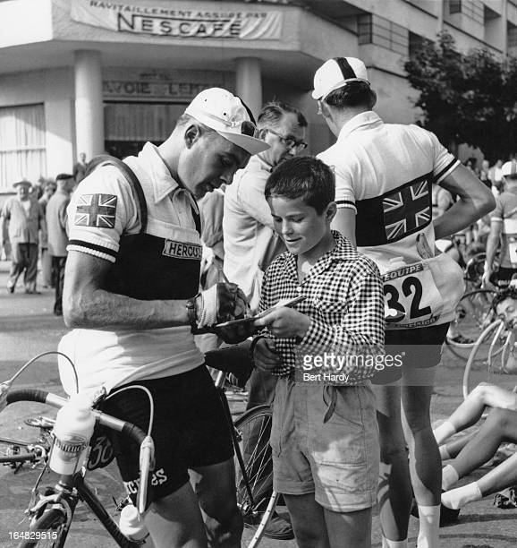 British cyclist Brian Robinson signs an autograph for a fan during the ninth stage of the Tour de France between Briancon and Monaco 15th July 1955...