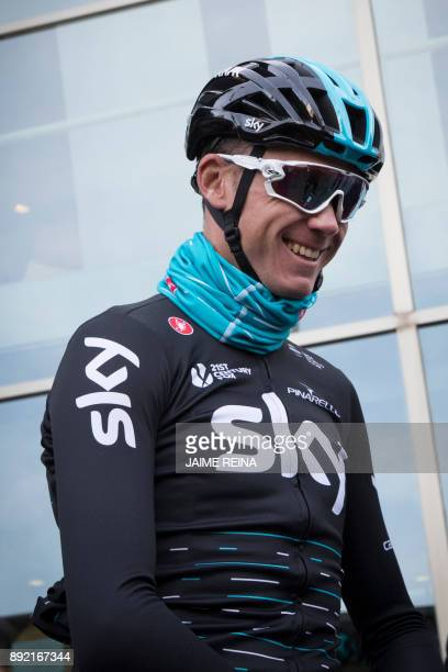 British cyclist Chris Froome of Sky Team smiles on his way to a training session in Port de Alcudia on the Spanish island of Mallorca on December 14...