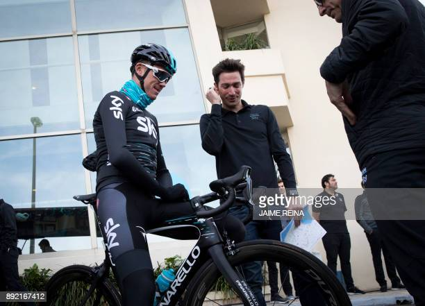 British cyclist Chris Froome of Sky Team speaks to team members on his way to a training session in Port de Alcudia on the Spanish island of Mallorca...