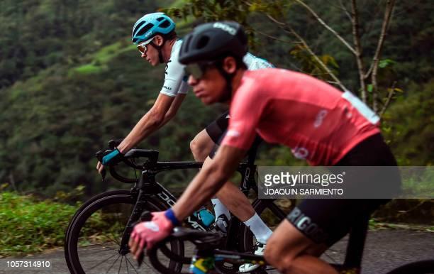 British cyclist Chris Froome rides next to Rigoberto Uran during of the Giro de Rigo in San Rafael, Antioquia«s Department, on November 4, 2018. The...