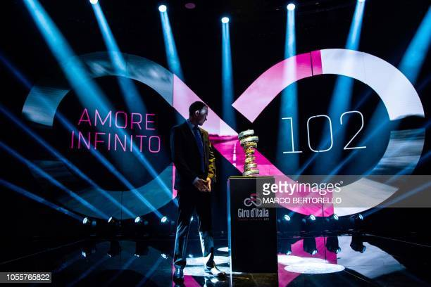 British cyclist Christopher Froome and Giro 2018 winner poses near the Giro trophy during the presentation of the official route of the 102nd edition...