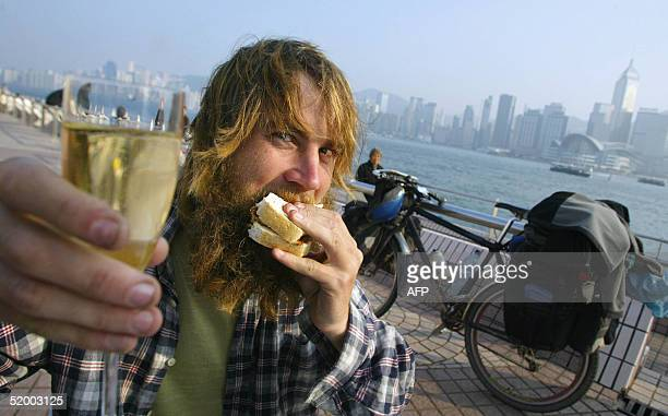 British cyclist Edward Genochio was greeted with a cheese sandwich and champagne by the British Consulate while he arrives in Hong Kong after 10...