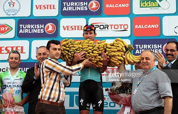 British cyclist Mark Cavendish receives Alanya bananas after winning the first stage of the 51st Presidential Cycling Tour of Turkey in Antalya on...