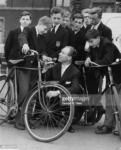 British cyclist Reg Harris teaches road safety and bicycle maintenance to the boys of St Paul's School in Hammersmith, London, during the 1958 Summer...