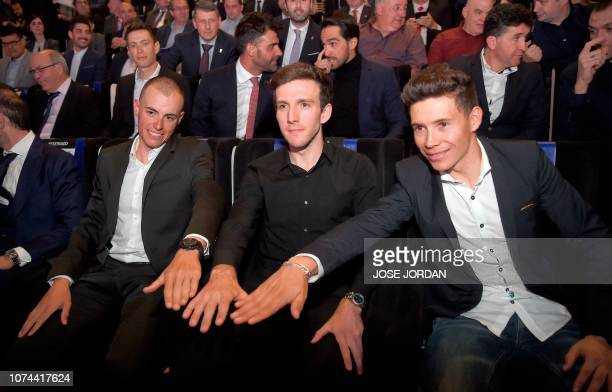 British cyclist Simon Yates Spanish cyclist Enric Mas and Spanish cyclist Miguel Angel Lopez pose during the presentation of the 74h La Vuelta...