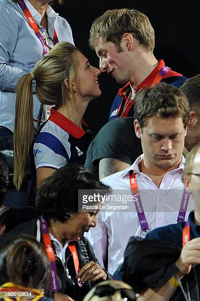 British cyclists Laura Trott and Jason Kenny during the Beach Volleyball on Day 12 of the London 2012 Olympic Games at Horse Guards Parade on August...