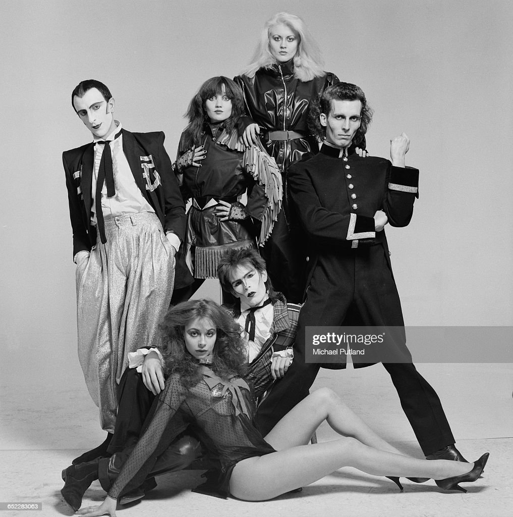 British dance, mime and pop group, Shock, 1980. Clockwise, from left: Tim Dry, Barbie Wilde, LA Richards, Robert Pereno, Sean Crawford and Carole Caplin. Dry and Crawford later formed robotic mime duo Tik and Tok. Caplin later found employment as style and fitness adviser to Tony and Cherie Blair.