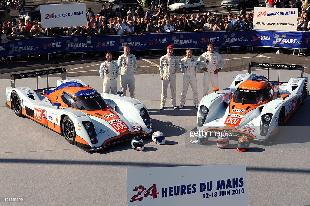 British Darren Turner, Sam Hancok (L), Swiss Harold Primat, Mexican Adrian Fernandez and German Stefan Mucke (R) pose next to their Lola B09/60 Aston Martin N° 009 and 007 on June 6, 2010 in Le Mans, western France. Fifty-six cars with 168 drivers will participate on June 12 and 13 in the 78th edition of the Le 24-hour endurance race.