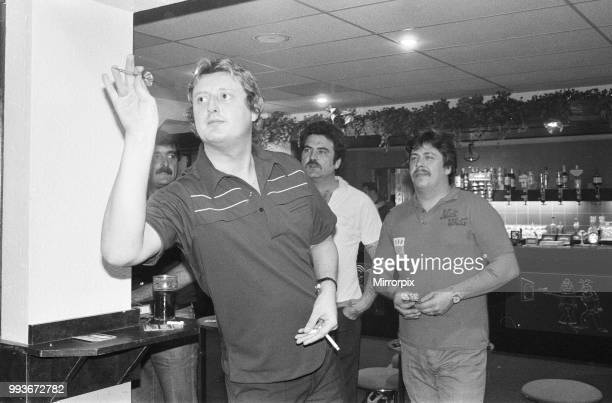 British dart player Eric Bristow pictured at the pub enjoying a friendly game with the locals November 1984