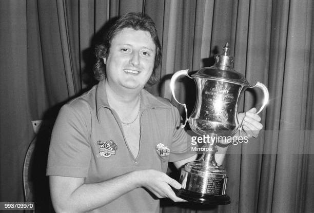 British dart player Eric Bristow poses with the World Championship trophy before his contest against John Lowe in th Embassy final at Lakeside 18th...