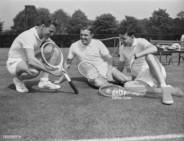 British Davis Cup team coach George Worthington in discussion with tennis players Roger Becker and Michael Davies during a practice session for the...