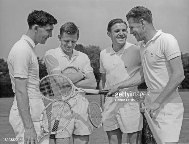 British Davis Cup team tennis players Michael Davies, Billy Knight and Roger Becker in discussion with their team coach George Worthington during a...