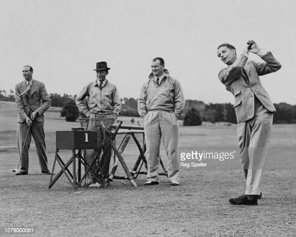 British Davis Cup tennis player Bunny Austin drives the ball off the 1st tee of the Royal Automobile Country Club course watched by trainer Tom...