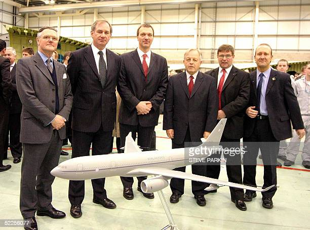 British Defence Secretary Geoff Hoon Eads Ceo's Philippe Camus Managing Director Ian Gray and a members of the Airbus Staff pose in front of a...