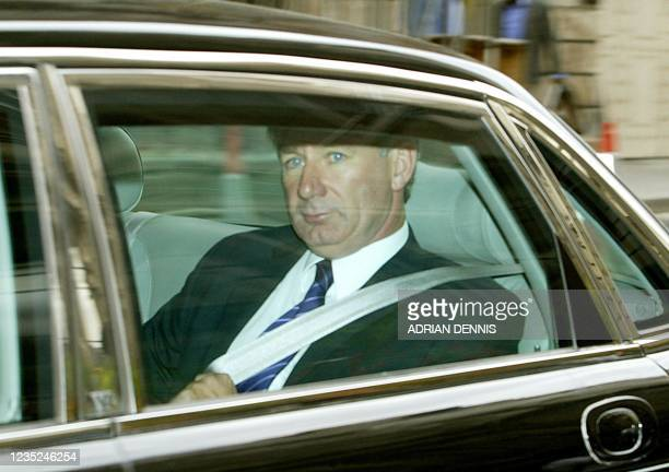 British Defence Secretary Geoff Hoon leaves the Hutton Inquiry at the Royal Courts of Justice in London 22 September 2003 after being called back to...