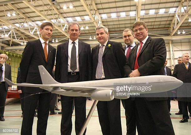 British Defence Secretary Geoff Hoon Member of Parliament Mark Tami Managing Director John Wall and a member of the Airbus Staff pose in front of a...