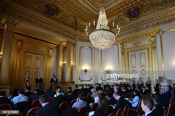 British Defence Secretary Michael Fallon and US Secretary of Defense Ashton Carter speak during a press conference at Lancaster House in central...