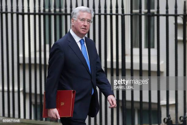 British Defence Secretary Michael Fallon arrives for the weekly cabinet meeting at 10 Downing Street in central London on March 29 2017 British Prime...