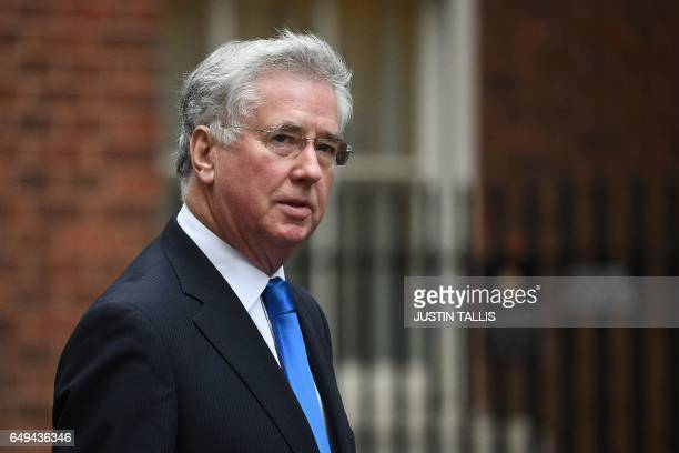 British Defence Secretary Michael Fallon arrives to attend a prebudget cabinet meeting at 10 Downing Street in London on March 8 2017 British finance...