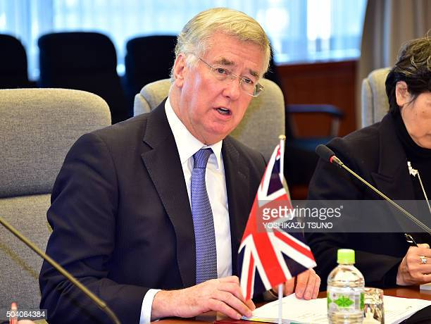 British Defence Secretary Michael Fallon talks with his Japanese counterpart Gen Nakatani at the defence ministry in Tokyo on January 9 2016 Fallon...