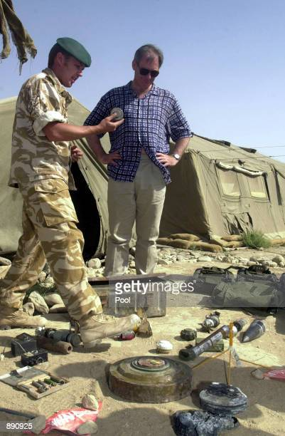 British Defense Secretary Geoff Hoon is shown mines encountered by coalition troops in Afghanistan during his visit with Royal Marines from 45...