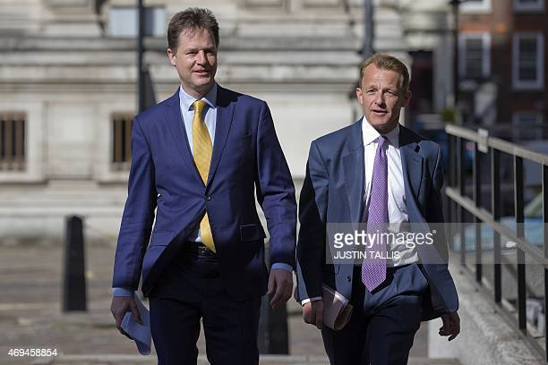 British Deputy Prime Minister and leader of the Liberal Democratic Party Nick Clegg and Minister of State for Schools David Laws arrive to give a...